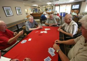 Santa Rosa Country Club members enjoy a card game. Many have known each other for years and share a community. (Photo: J. Omar Ornelas/ The Desert Sun)